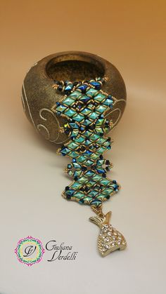 My Minerva bracelet, created with Diamond Duo Beads, O beads, Bicone and Seed Beads. My pattern on Etsy. Jet Ab and Turquoise Ab. September 2016.