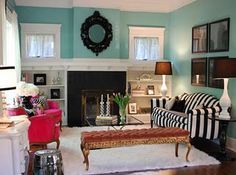 Love the mix match of furniture with the blue walls.