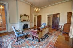 The living room of the Colonial Revival home at Ben Dover Farm in Manakin-Sabot, Va., features soaring ceilings and an impressive marble fireplace mantle.
