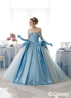 These Disney Princess-inspired bridal dresses are fit for a fairy tale wedding, but here's the catch Disney Inspired Wedding Dresses, Princess Style Wedding Dresses, Cinderella Wedding, Blue Wedding Dresses, Disney Dresses, Designer Wedding Dresses, Bridal Dresses, Wedding Gowns, Wedding Disney