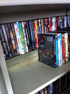 DVD Storage - A cheap way to double your DVD shelving space.  I bought a 4x4 and had it cut to size at home depot ($10 total).  Added it to my shelf and was able to create an additional tier of DVD's, doubling the storage.  Cheap and quick!