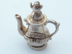 5g XL Sterling Silver Charm Home Sweet Home Teapot ...Sold in Jan.2013 for $69. Another sold for 46USD