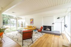 A fireplace in the den.  Photo 27 of 1347 in Best Living Sofa Photos from A Meticulously Updated Midcentury in L.A. Asks $1.49M. Browse inspirational photos of modern living rooms.