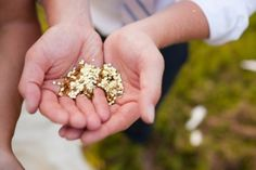 Gold large confetti to throw at the couple