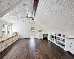 Dark floors with white walls and lots of storage