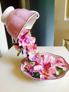 MANDIE'S FLOATING TEACUP | Grillo Designs using fork, bent and glued on both ends. Then glue petals from faux flowers!