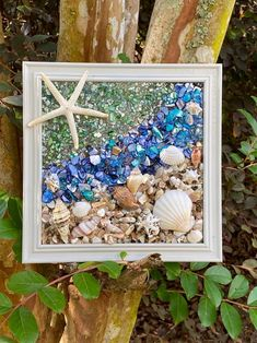 "8""x 8"" Beach Glass Wall and/or Window Art/Seashell Art/Resin Art/Unique Coastal Decor/Beach House Decor/Sun Catcher/Great Christmas Gift  Handmade in South Carolina with high quality materials (seashells, crushed shells, sand pebbles, finger starfish) and secured with care. The design is bonded (not Nautical Wall Art, Coastal Wall Art, Coastal Decor, Beach Cottage Style, Beach House Decor, Seashells, Starfish, Turtle Gifts, Seashell Art"