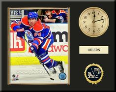 One 8 x 10 inch Edmonton Oilers photo of Nal Yakupov inserted in a gold slide-in frame and mounted on a 12 x 15 inch solid black finish plaque.  Also features a 3-inch Arabian gold-faced clock, a customizable nameplate* and a 2-inch hockey medallion with a gold base. $59.99  @ ArtandMore.com