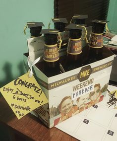 College graduation gift for my boyfriend! Paper graduation hats on a 6 pack of beer. Cute and easy