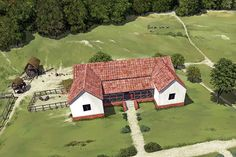 Reconstruction painting bird's eye view of the first villa at Lullingstone, dating from about AD 100