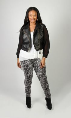 Leather jacket paired with animal leggings for a perfect fall look.