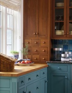 Coastal Kitchen - combination of natural wood cabinets and blue cabinets.