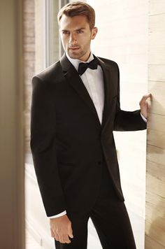 A semiformal wedding on a winter evening calls for a classic tuxedo, like this Two-Button Notch Lapel style by BLACK by Vera Wang.