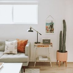 Vintage Decor Living Room Modern southwest decor in a living room design featuring a large potted cactus, vintage desert scene wall hanging, and ethnic patterned pillows - Southwestern Decor Home Living Room, Living Room Designs, Living Room Decor, Living Spaces, Small Living, Office Inspiration, Decoration Inspiration, Decor Ideas, Room Ideas