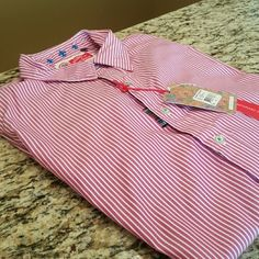 """MEN'S NWT Robert Graham pink & white striped shirt NWT MEN'S Robert Graham button front long sleeve shirt from """"The Freshly Laundered"""" collection. Super soft 100% cotton pink and white stripes that could also read as a very muted red. Exposed blue stiching on side of shirt as seen in 3rd picture, subtle details throughout and collar stays are included. Also included is the """"freshly laundered"""" dustbag as seen in 4th picture. Size XL but shirt is contemporary fit so probably more appropriate…"""