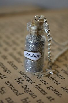 Hey, I found this really awesome Etsy listing at http://www.etsy.com/ru/listing/85217496/stardust-glass-vial-necklace