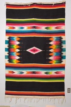 It might just be in style right now, but I really want a Mexican rug and a white living room..