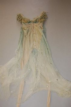Margot Fonteyn's costume from `Ondine', designed by Lili de Nobili, 1958, comprising: tiered, floating gown of aquamarine chiffon spotted with pastes, with jewelled brooch to breast, with integral flesh coloured stockinette body stocking