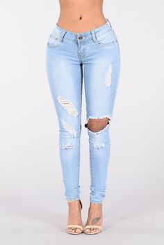 - Available in Light Blue - Low Rise - 5 Pocket Design - Distressed - Skinny Leg - 80% Cotton, 15% Polyester, 5% Spandex
