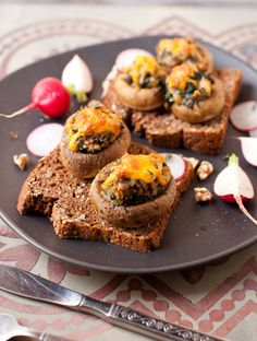 Stuffed mushrooms with spinach and walnuts on toast