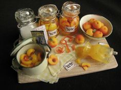 Good enough to eat! The artist, Betsy Niederer, has a peaches tutorial at  http://www.cdhm.org/tutorials/learn-to-sculpt-miniature-peaches.html