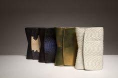 Narciso Rodriguez 'Rachel' evening bag in black/tan python + nappa, indigo/black python + nappa, bronze metallic leather, and off-white snake for Resort 2017.