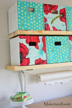 Cardboard, mod podge, fabric, and a glue gun. Economic way to make stroage containers