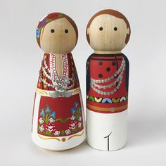 Peg People by thepaintedpeg It's hard to pick a favorite from the group I recently finished painting. But my Bulgarian friends definitely top the list, mostly because of the time I spent there and the love I developed for the country, the people and their culture. Their traditional clothing includes wonderfully rich colors and textures. Makes a girl with teeny brushes and a love for details very very happy. #thepaintedpeg #pegdolls #pegpeople #tppmulticulturalfriends #bulgaria