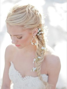 7 Braided Wedding Hair Looks -  Fishtail Braid Long hair looks lovely pulled back into a tight fishtail braid. Sprinkle with baby's breathe for a more organic touch.