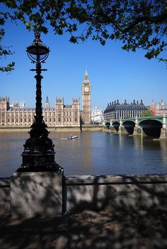 Big Ben, The Houses of Parliament, and Westminster Bridge from across the river Thames by Roy McGrail