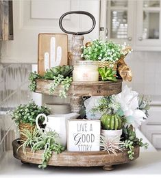 We do love a beautifully styled tiered tray, and this one sure is pretty! The su… We do love a beautifully styled tiered tray, and this one sure is pretty! The succulents add a lovely pop of fresh attitude to our Distressed Tiered Tray too! Tray Decor, Decoration Table, Cheap Home Decor, Diy Home Decor, Room Decor, Decor Crafts, Diy Crafts, Tray Styling, Styling Tips
