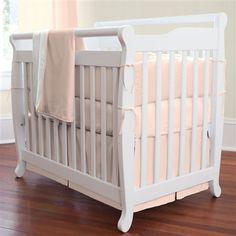 Solid Peach Mini Crib Bedding by Carousel Designs.