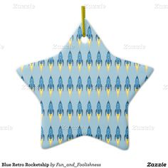 Christmas Ornament - Blue Retro Cartoon Rocket Ship Star Ornament - This geeky and funny design has a blue retro rocketship blasting off into outerspace. Makes a great geek humor gift for the rocket scientist, space cadet, nasa enthusiast, or someone interested in space exploration, aerospace science, aeronautical engineering, etc. Cartoon design is great for the young at heart. #rocketgeek #cartoongiftsforgrownups