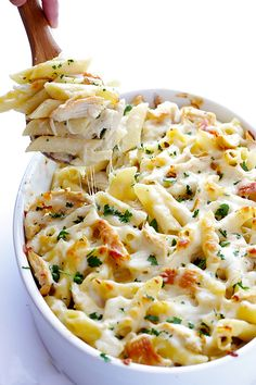 Delicious chicken and ziti are tossed with a lighter alfredo sauce and baked up to cheesy perfection.