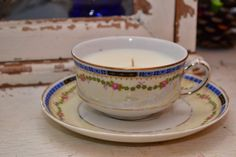 Candle in a vintage a heinrich & co tea cup with saucer $12 shopellion