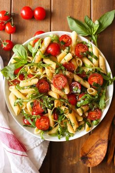 Simple balsamic pasta salad with fresh cherry tomatoes, arugula and basil in an easy vinaigrette. Serve as a side dish or light meal.   Gluten Free + Vegan