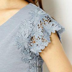 TSelnokruzhevnoy rukavchik la ropa A la moda y el diseño del interior por las manos