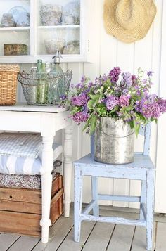 To style bathroom floor - Use bucket/or metal milk can filled with flowers, stack of pillows, wire basket with bathroom products in.