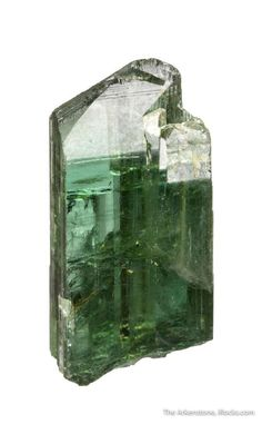 Zoisite, Ca2Al3(Si2O7)(SiO4)O(OH), Skardu District, Baltistan, Gilgit-Baltistan, Pakistan. Dimensions: 3.0 x 1.4 x 1.3 cm. This glassy and gemmy zoisite crystal exhibits a beautiful, light forest-green color. It has the same chemical composition as the zoisite (var. tanzanite) crystals from Merelani