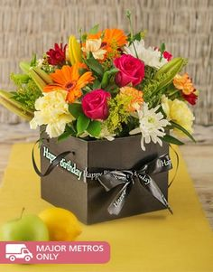 Buy or Send a colourful mix of seasonal flowers arranged in a black box, this gift can be sent to anyone for any occasion in South Africa.