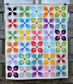 This listing is for the Little Blooms quilt pattern only. It is available for instant download. There are no shipping charges.    This fresh and