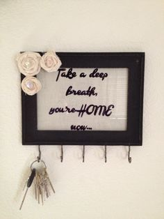 DIY key holder- decorate a picture frame and add hooks