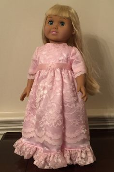 A personal favorite from my Etsy shop https://www.etsy.com/listing/249779941/pink-lacy-evening-gown-for-18-doll