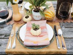 Individual succulent-in-a-gourd place settings