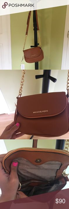 Michael Kors Crossbody Purse Brand new. Too small for my liking and was a gift. Camel/ tan colored. Really cute! Michael Kors Sweaters Crew & Scoop Necks