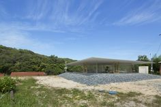 Hiroshima Hut — A house has roof to suspend a thin cover on a natural hill by Suppose design office – re|d
