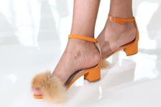 Orange ankle-strap sandals with fur detail at Brother Vellies spring '16.