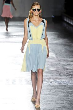 Prada Spring 2012 collection. Baby blue and pale yellow and black graphic print v-neck sleeveless dress with accordion pleats. Cool!