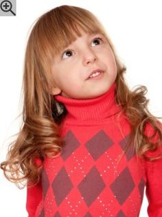 Long hairstyle with big curls for young girls. The bangs are long, straight and blunt cut.