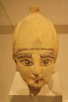 A Cypriot (Archaic) Terracotta Head of a Man, with Extensive Polychrome Preservation Archaic,ca 600 BCE,said to be from Amathus.